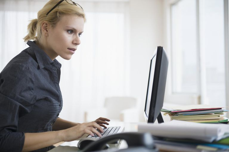 Young woman working at desk in office