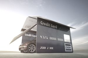 Car driving out of a garage made of credit cards