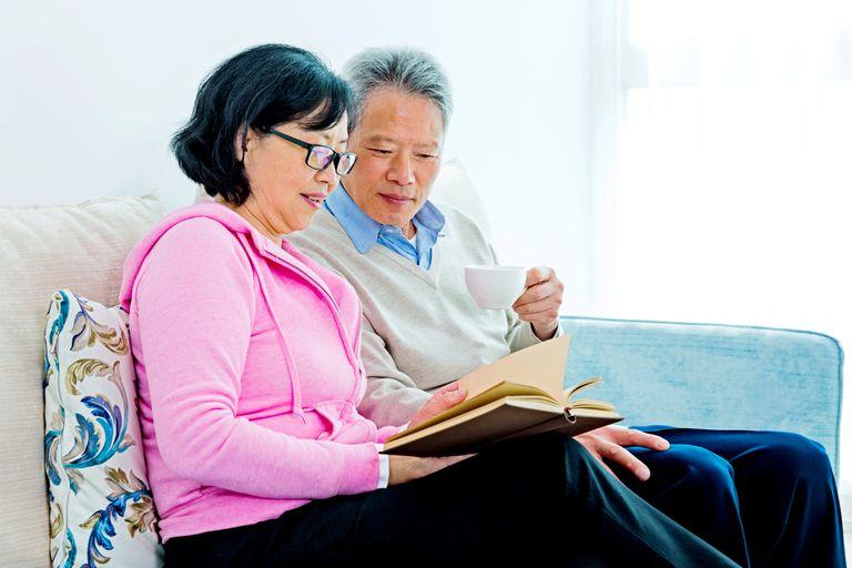 senior Asian couple reading book