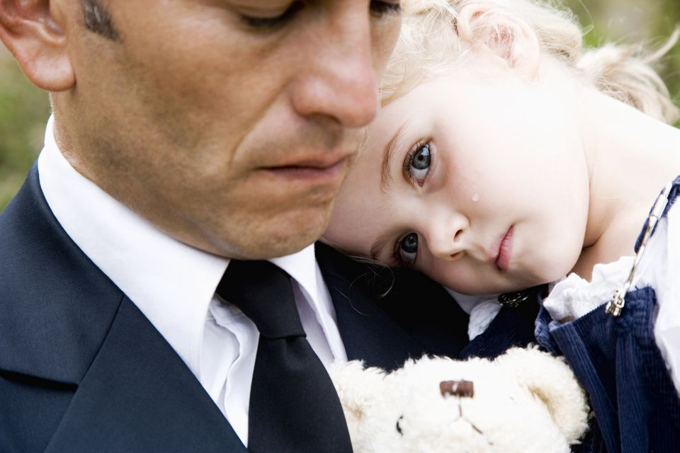Grieving man and child