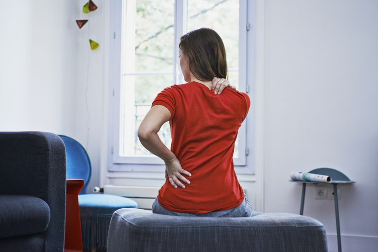 Woman suffering from back pain.