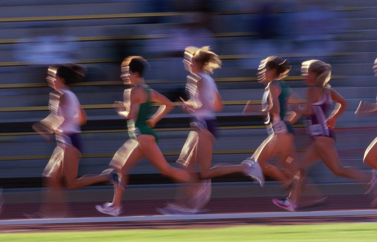 Female runners racing on track (Digital Enhancement)