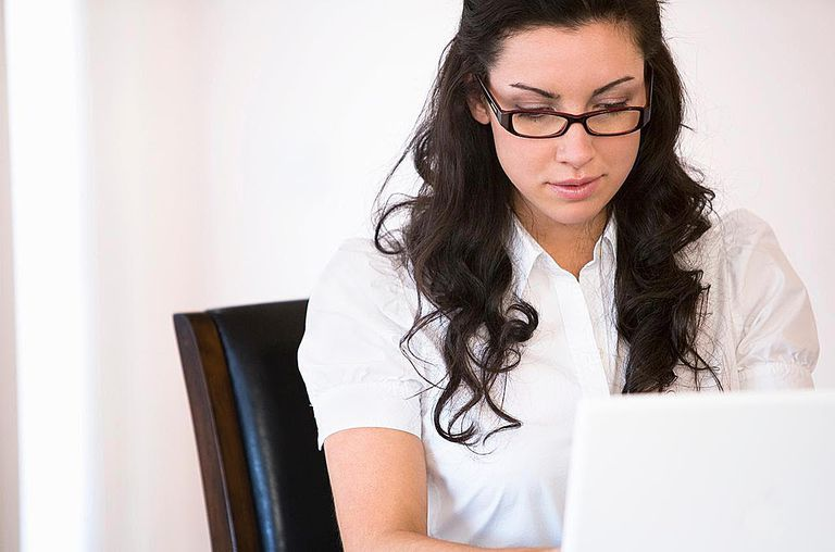 Young woman on computer at desk