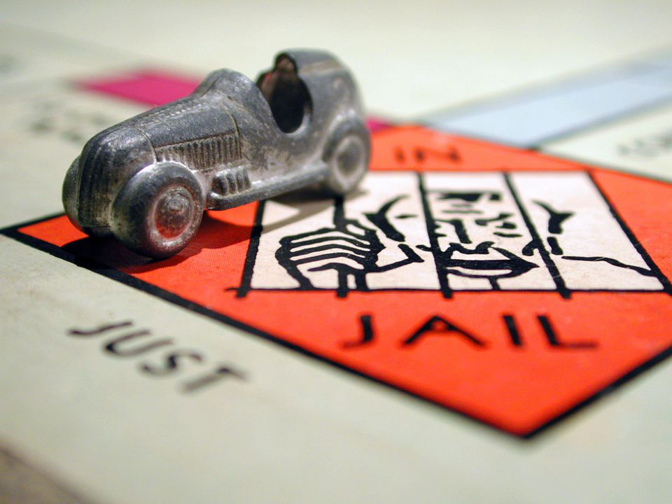 Monopoly game piece in jail