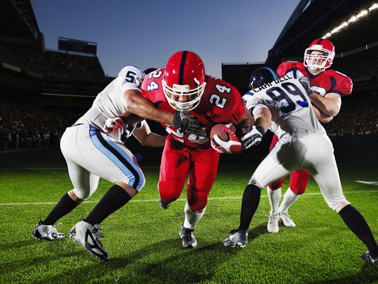 Image of men playing football, illustrating About.com's Super Bowl Sweepstakes List.
