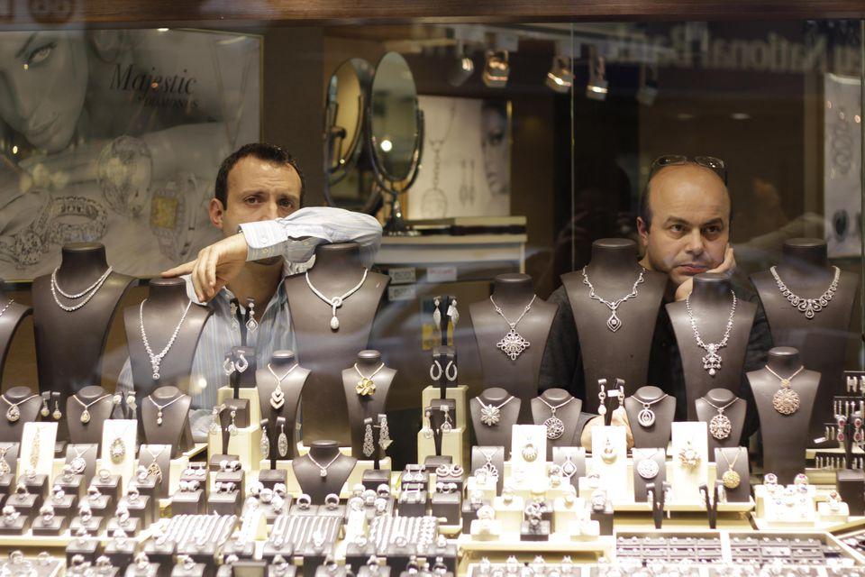Two men in jewelry store window Diamond District, Manhattan