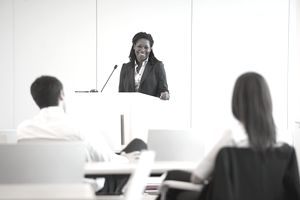 Black businesswoman speaking at podium