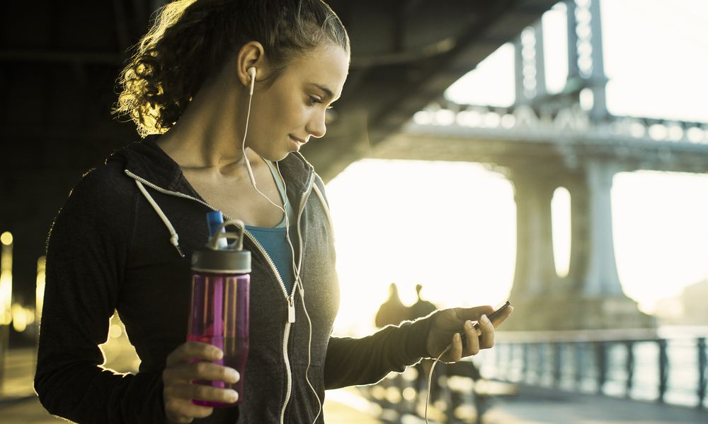 Young female runner MP3 player