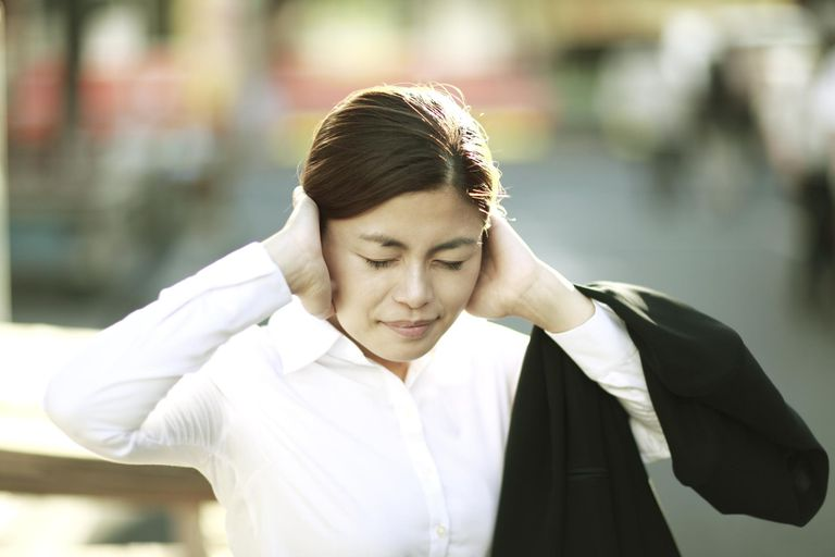 Businesswoman have closed her ears
