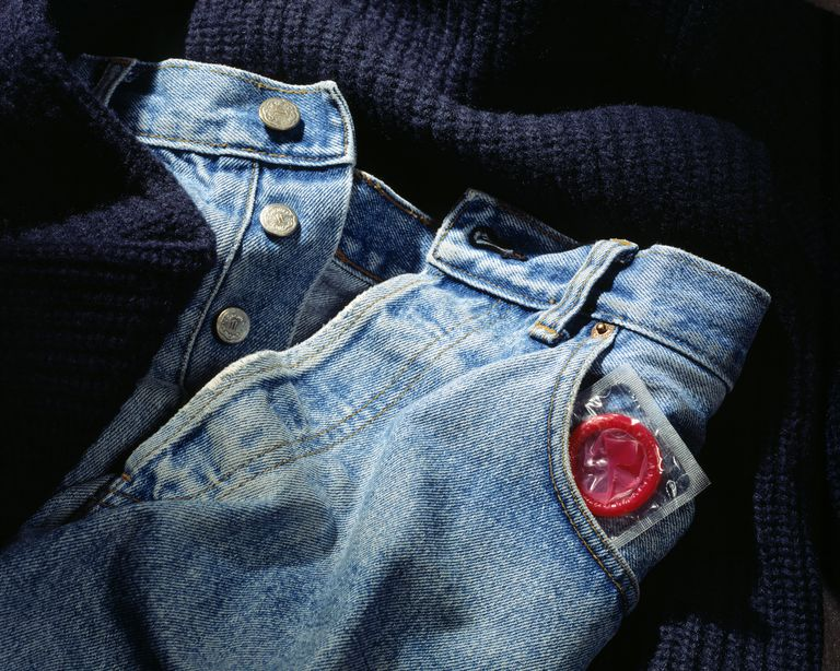 Sealed condom poking out of a jeans pant pocket