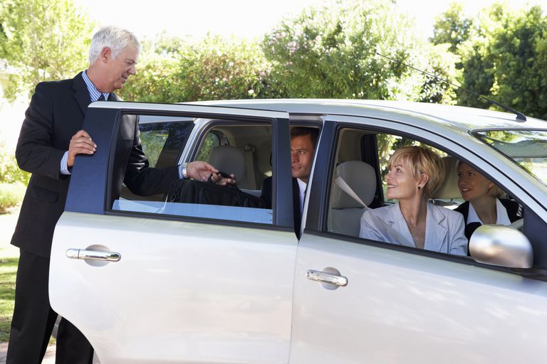 Group-of-business-colleagues-car-pooling-journey-into-work-mark-bowden-vetta.jpg