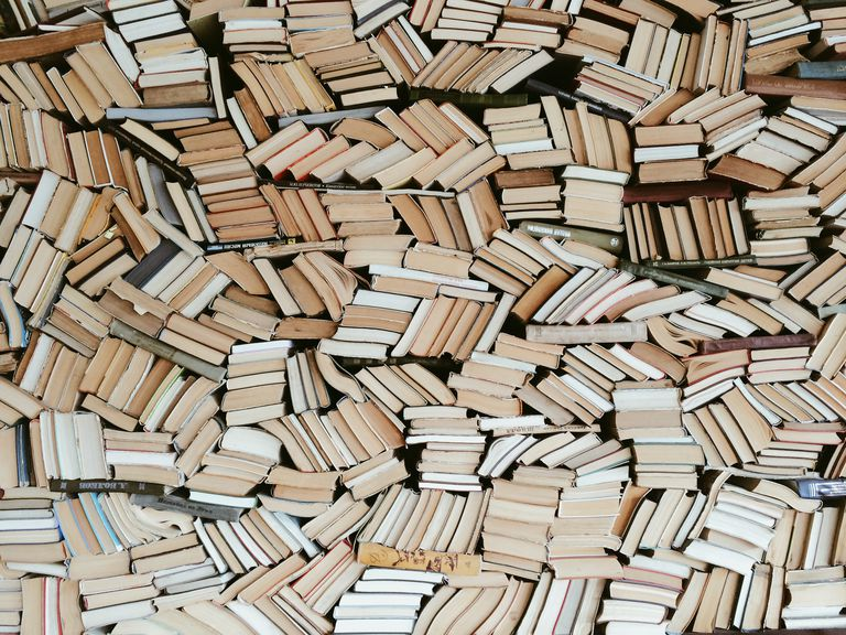 Hundreds of books in chaotic order