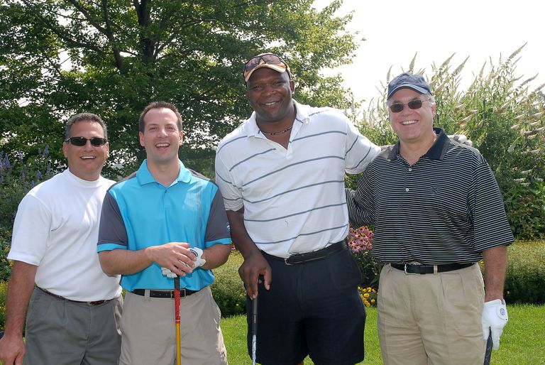 Group of four golfers at a charity tournament