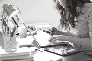 Businesswoman using technology in office