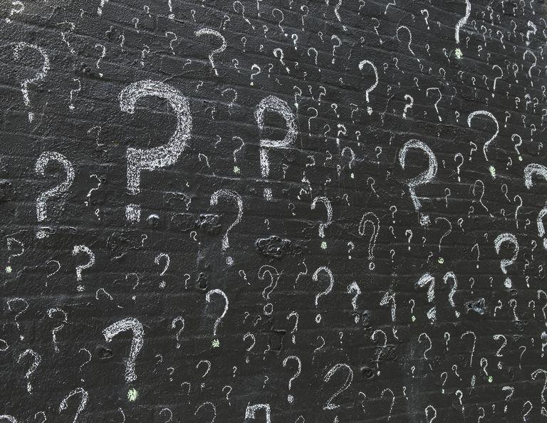 Question Mark Graffiti on a Brick Wall
