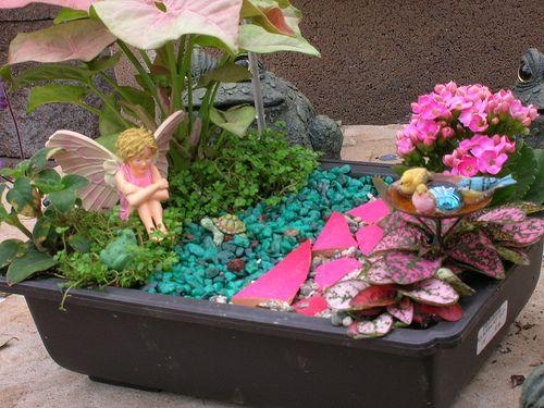 a feminine fairy garden