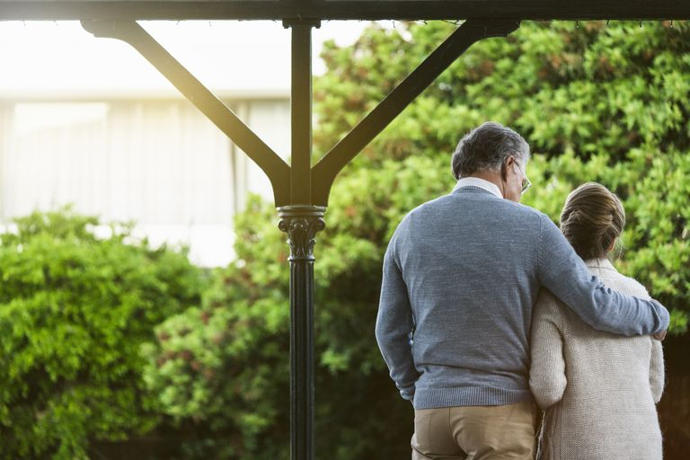 Rear view of senior couple standing at park