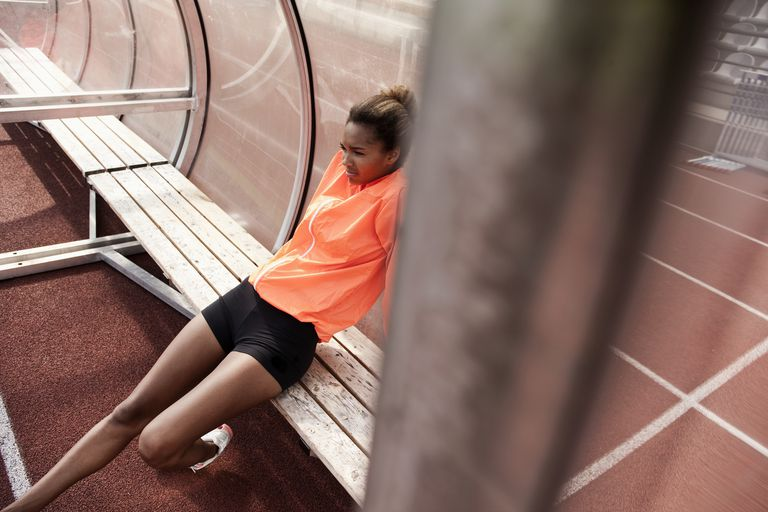 Young woman athlete resting