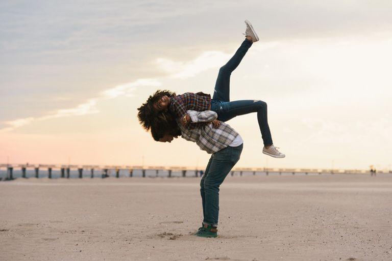 A couple having fun on the beach