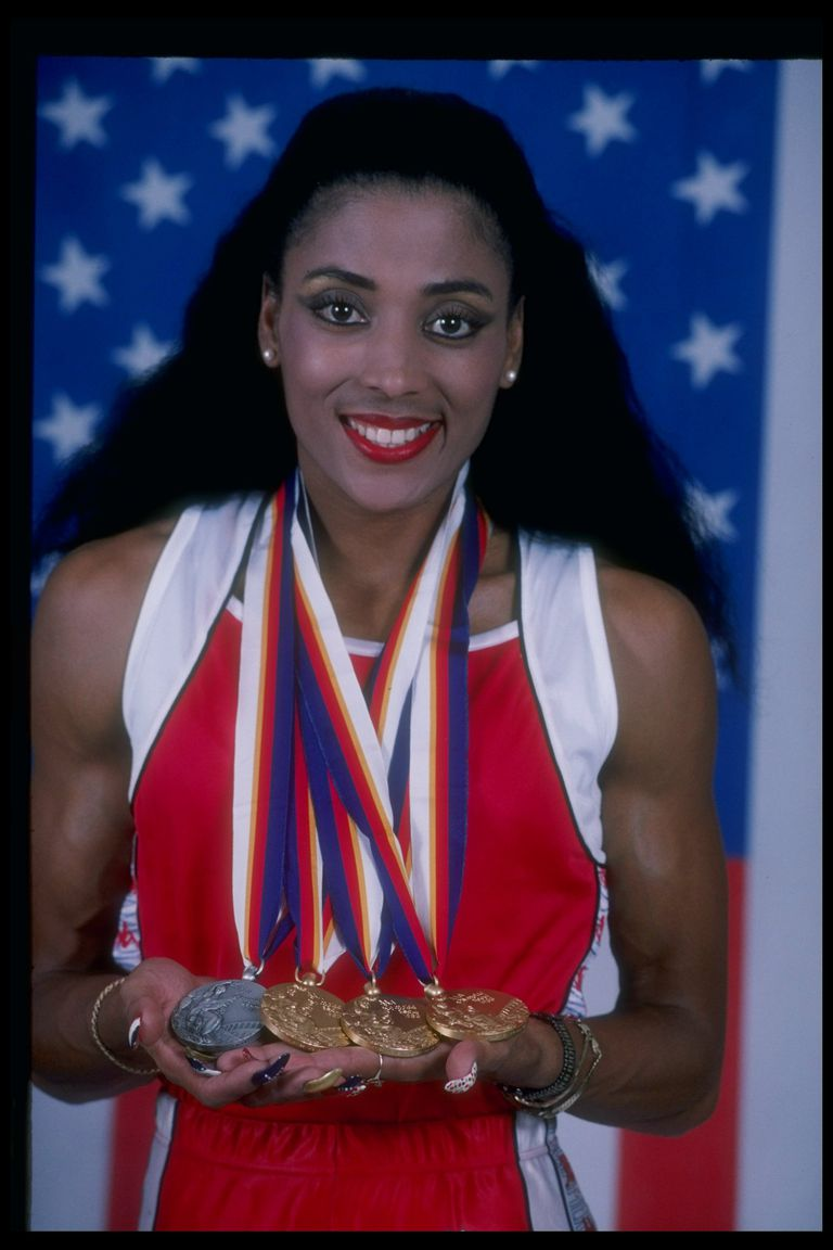 American Florence Griffith-Joyner displays her medals haul - three golds and one silver - after the 1988 Olympics, during which she set a world record in the 200 meters.