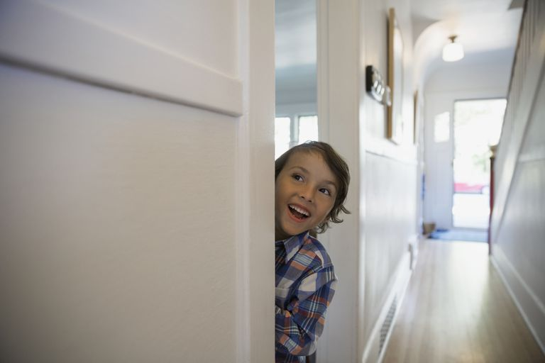 Child smiling in doorway