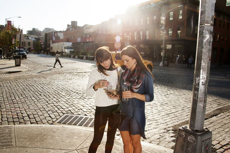 Friends looking a map on smartphone