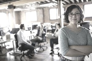 Portrait of confident Asian businesswoman in office