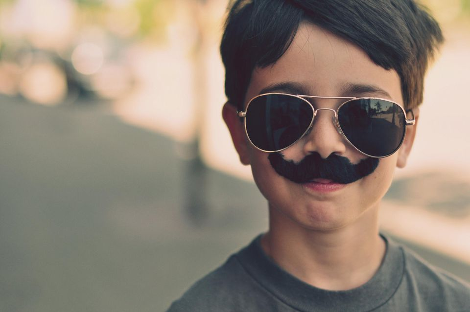 boy with sunglasses and fake mustache