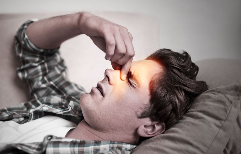 Man experiencing sinus pain from sinusitis