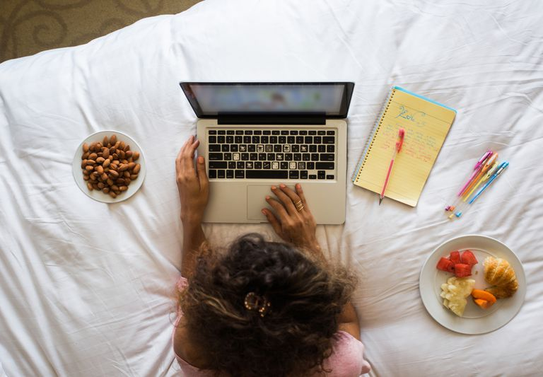 Woman using laptop to keep food diary
