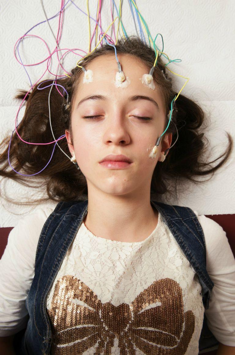 Young woman receiving EEG exam
