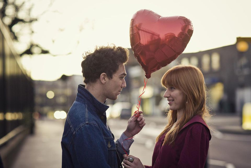 couple walking with heart shaped balloon - Valentines Day Los Angeles