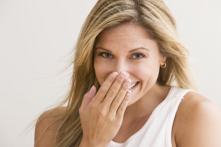 Embarrassed Woman Laughing