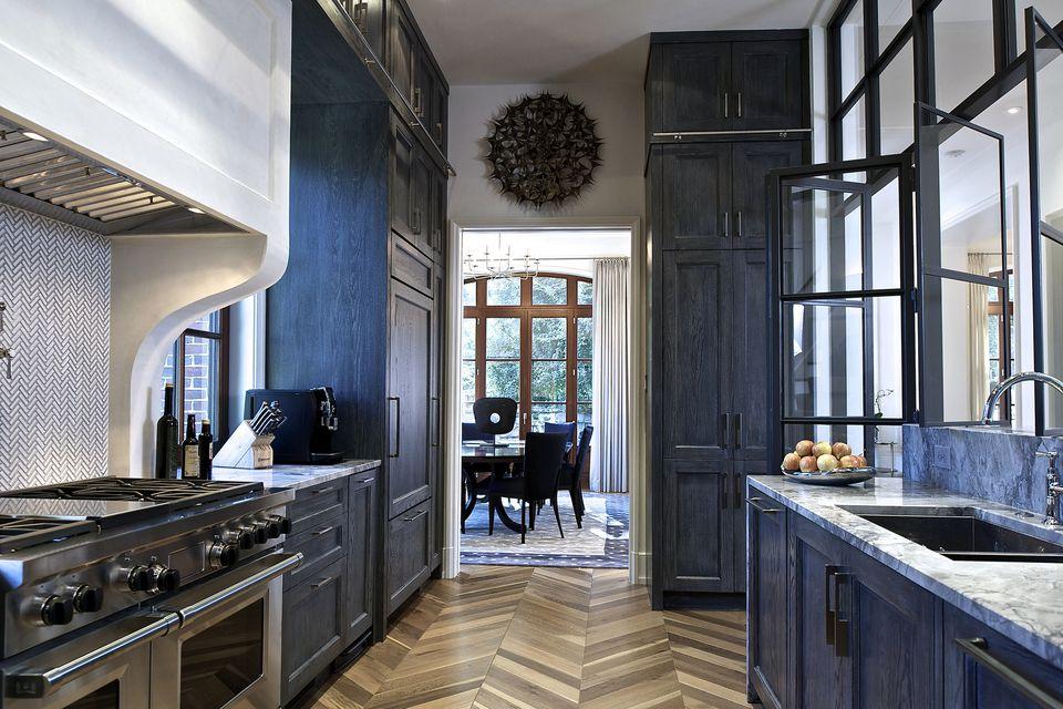 Beautiful White Kitchen Sub Zero With Blue Backsplash