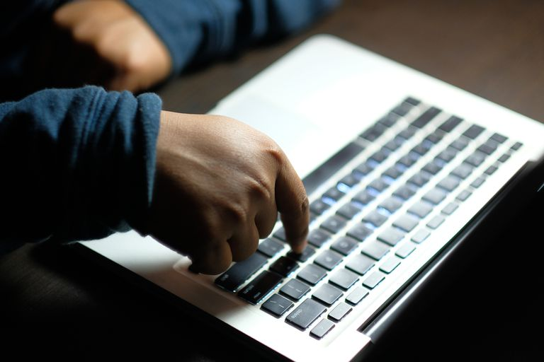 A man typing on a keyboard.