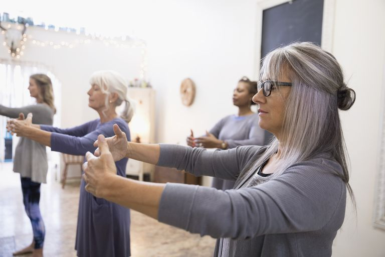 Serene women practicing tai chi in exercise class
