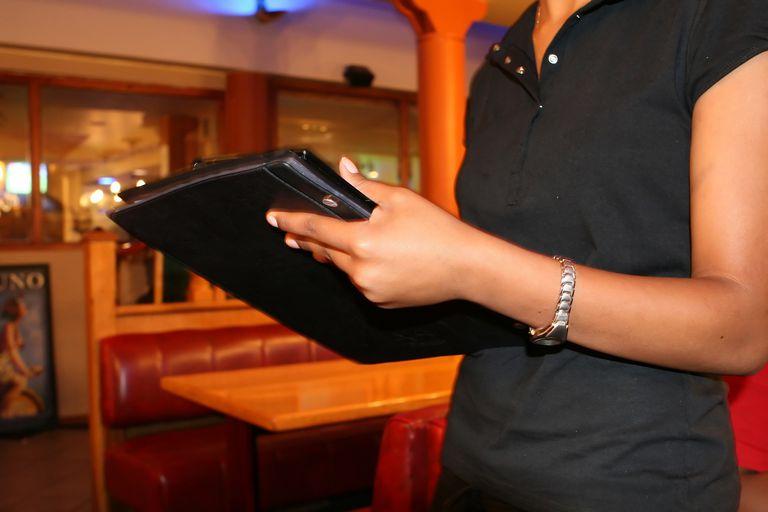 Restaurant owner holding menu