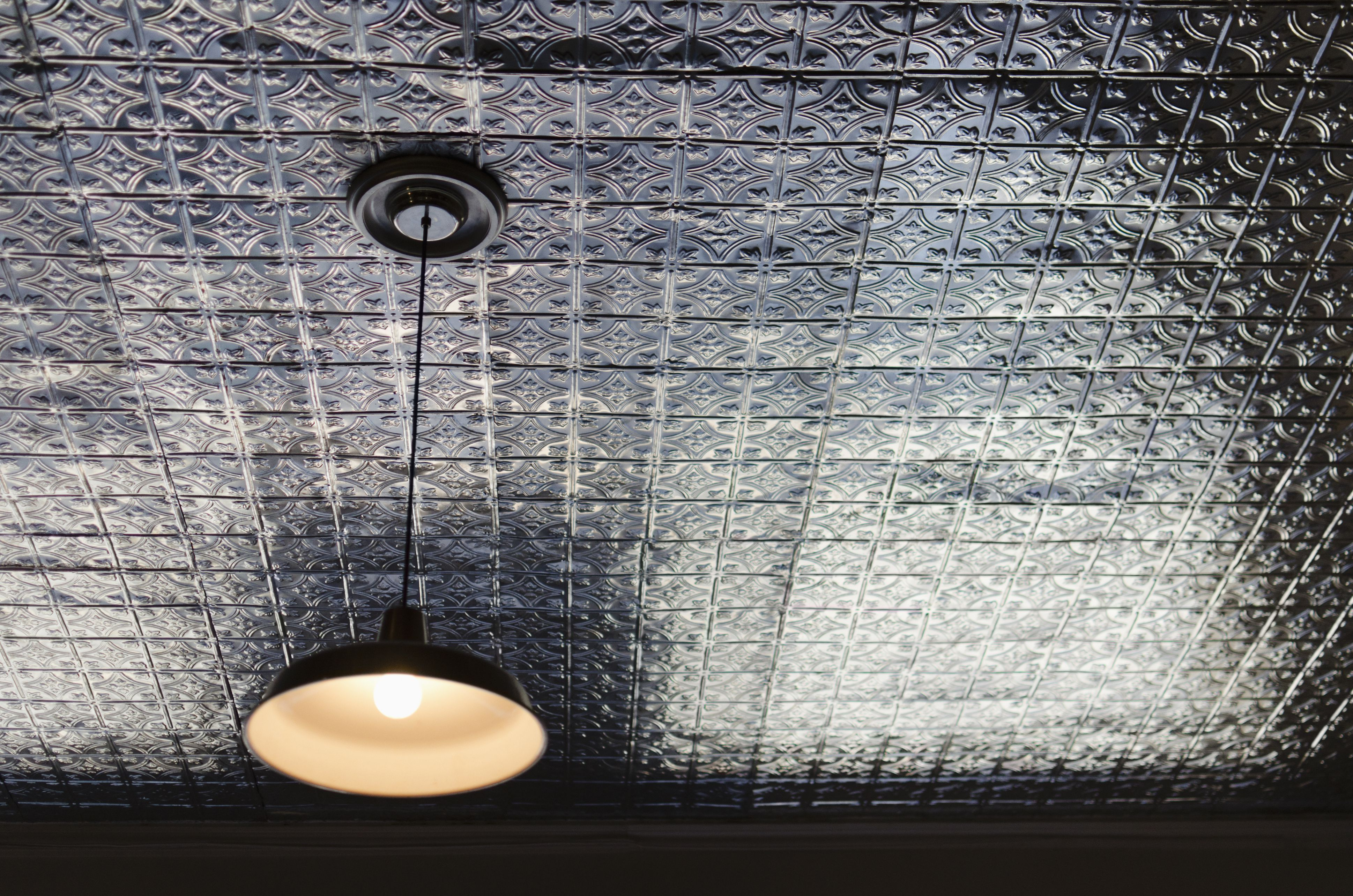 Interior wall covering ideas go for the old with metal and faux metal ceiling tiles dailygadgetfo Choice Image