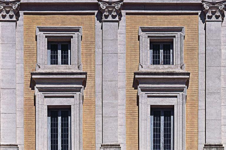 detail of renaissance villa with shallow pilasters separating vertical windows - View of the second and third floor of the facade, with angular smooth rustication and Ionic pilasters