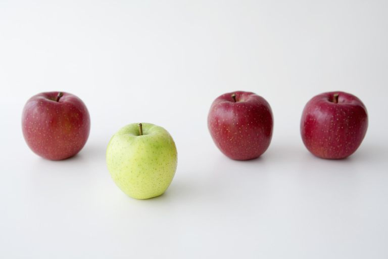 Some red apples and one green apples