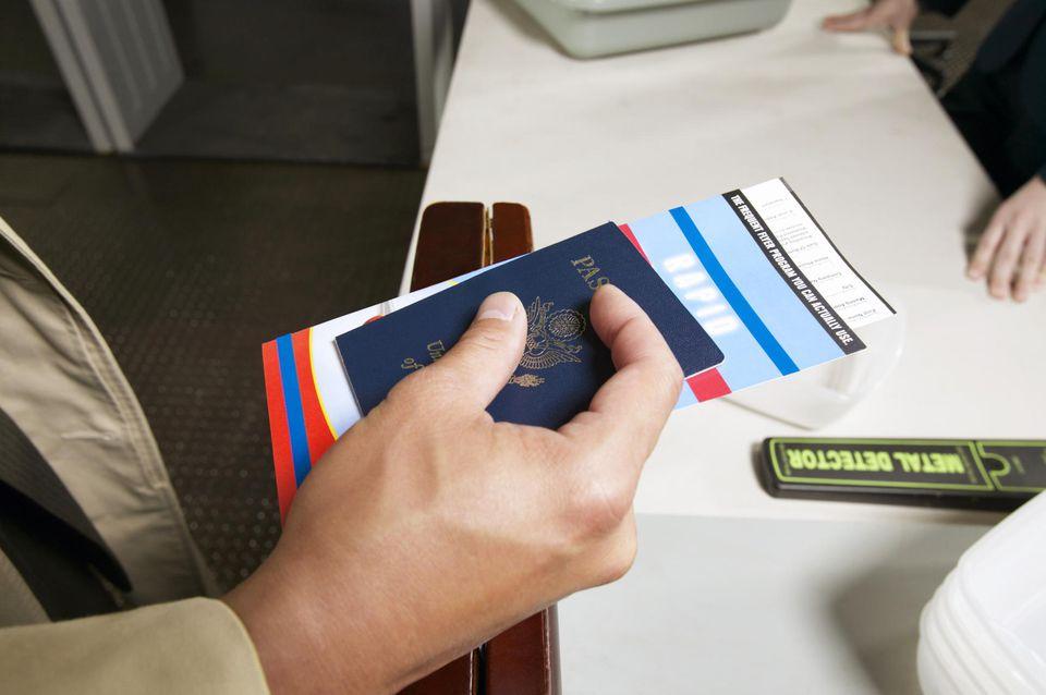 Close Up on a Man's Hand Holding a Passport