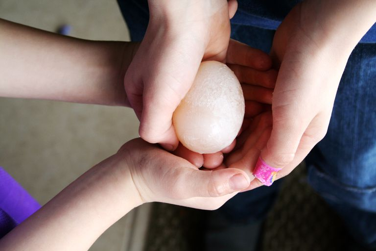 People holding hard boiled egg