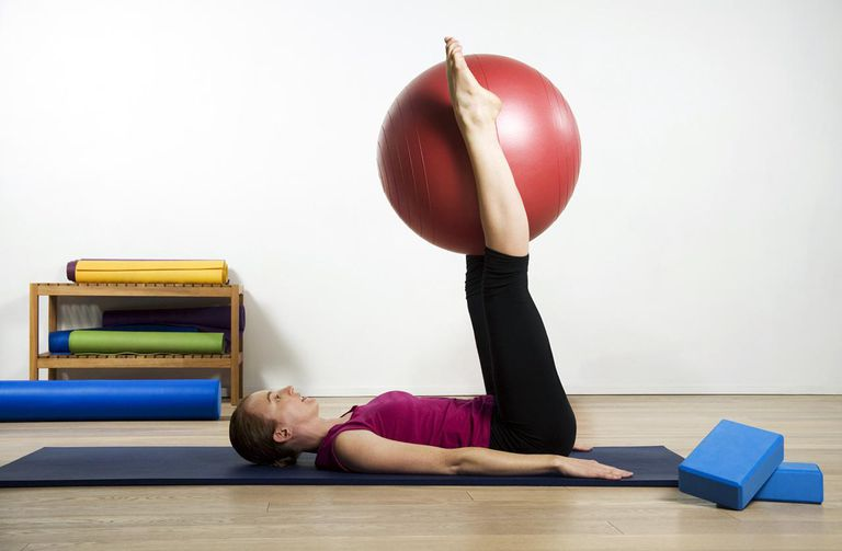 Woman Exercising Pilates