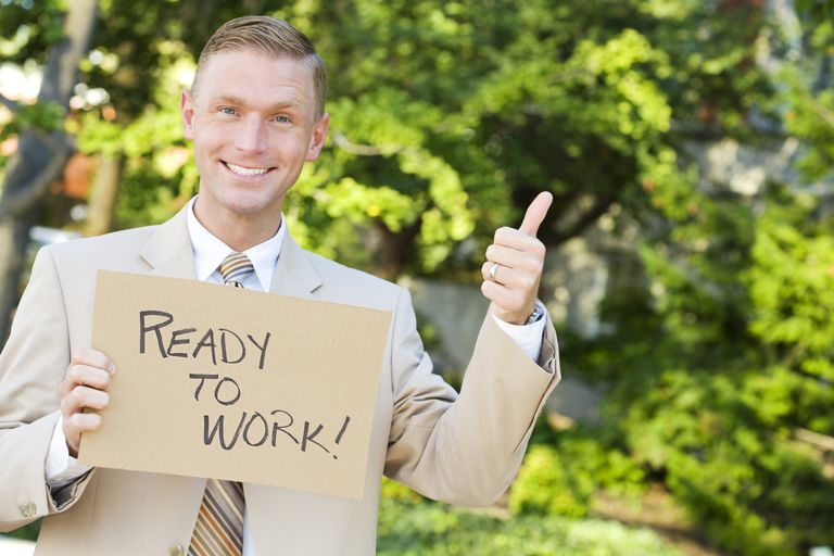 Unemployed man with ready to work sign