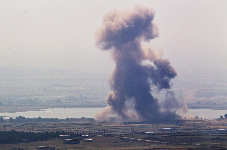 A cloud from an explosion rises near the Syrian village of Al' Rafide at the border with Israel May 7, 2013