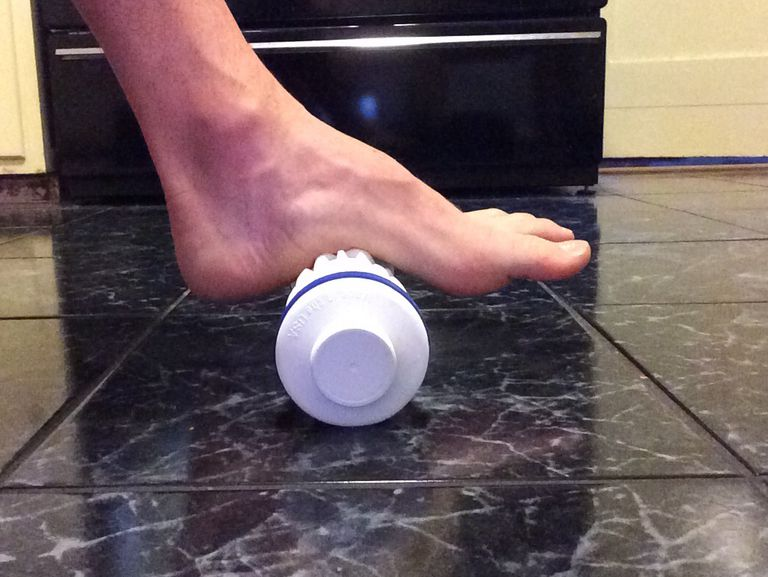 Use an ice bottle to treat plantar fasciitis.
