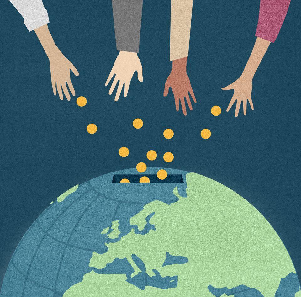 Hands donating money into world money box,