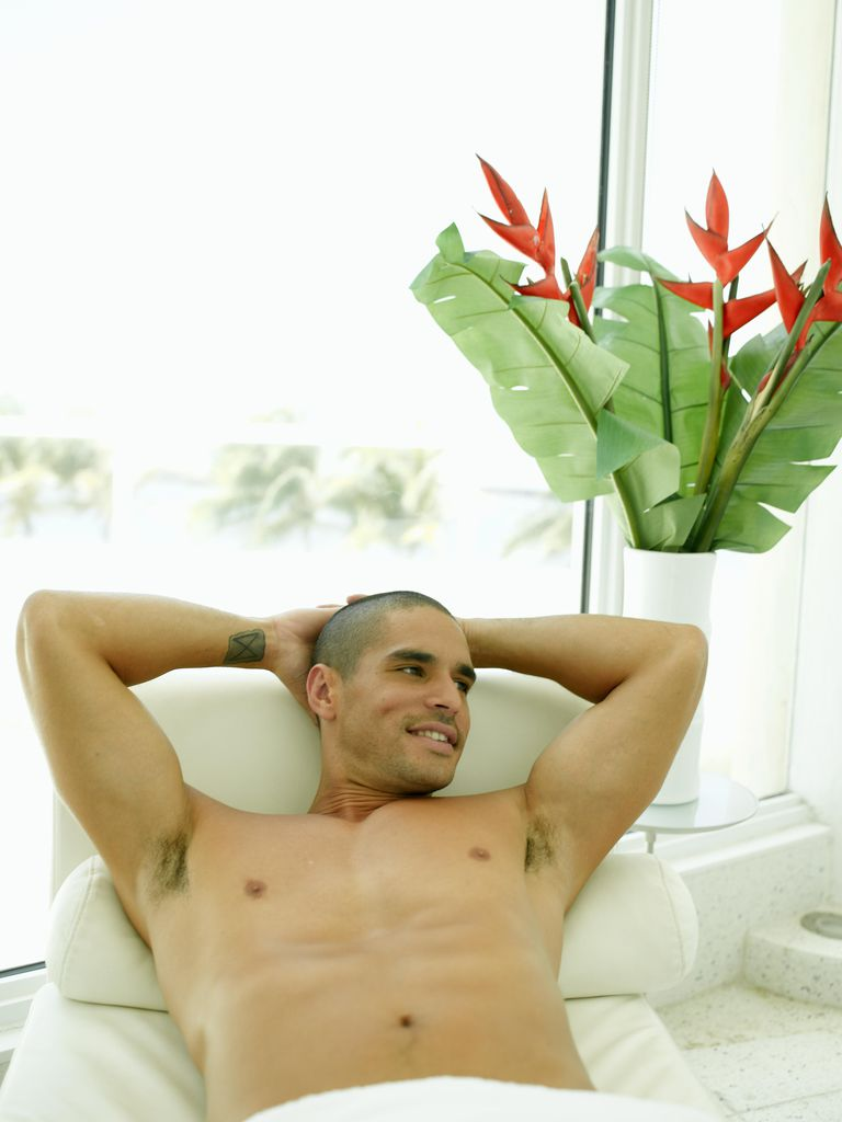 Man lying on massage table, smiling, elevated view