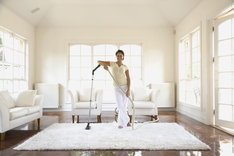 hispanic woman vacuuming floor - Best Vacuum For Furniture