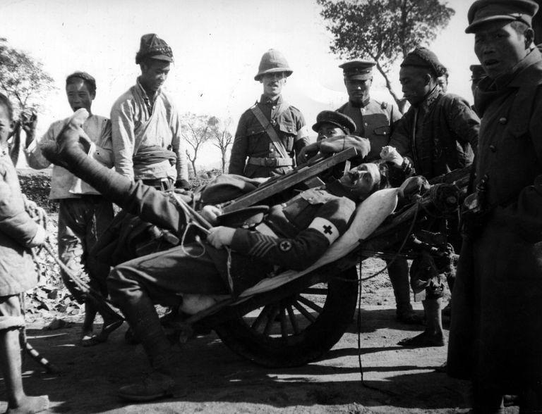 Wheelbarrow in action: A wounded British medical orderly is carted off the field at the Siege of Tsingtao (Qingdao) in World War I, November, 1914